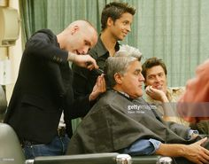 Comedian Jay Leno gets a make-over from the cast of 'Queer Eye for the Straight Guy' backstage on the Tonight Show with Jay Leno at NBC Studios, August 14, 2003 in Burbank, California.
