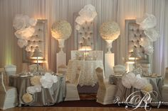 Paper flowers are a beautiful way to accent for backdrops and head tables.