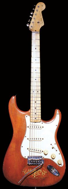 """Lenny"" A 1965 Fender Stratocaster Stevie found in a pawn shop in the early '80s but didn't have the $350 for. His wife Lenny and other friends bought the guitar for him. Original sunburst finish removed and brown stain applied. A butterfly tortoise-shell inlay in body, believed to be a 1910-era mandolin pickguard. It had a rosewood fretboard, later switched to maple neck that Billy Gibbons gave Stevie. It is reported that Stevie did the switch himself and used non-stock screws,"
