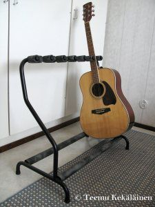Guitar rack, holds 7 instruments. Furniture steel pipe, brazed together with brass. Matte black paint.