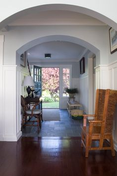 Coastal Home - Seaside Home - Entry - Foyer - Slate Floor - Board and Batten - High Chair Rail - Arched Doorway - Bench - Side Chair
