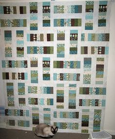 simple and fun JellyRoll quilt! This may be in my future :)