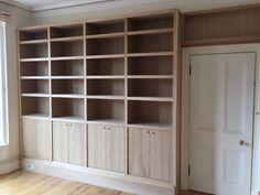 Custom built oak bookcases before spray finish.