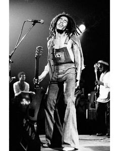 Bob Marley rocking overalls with rainbow shaped patch.