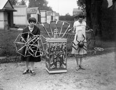 Two of the female workers at James Pain & Sons Firework factory display some of the elaborate fireworks produced by this London company.  Date: 01/02/1928