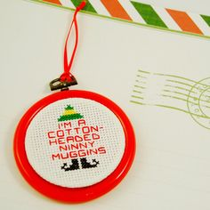 """I'm a Cotton-Headed Ninny Muggins """"Elf"""" cross stitch Christmas ornament from WhimseyLindsey on Etsy."""
