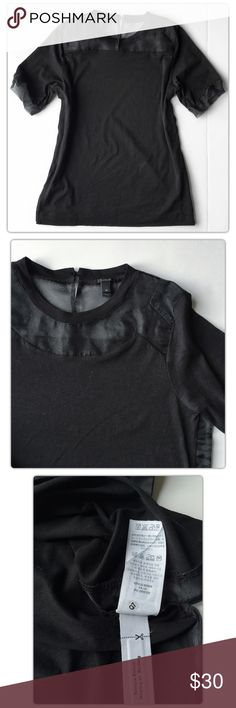 J. Crew Black Silk Cutout T-Shirt Size XS J. Crew Silk Cutout T-Shirt Size XS  Meet your new date top. Silk chiffon inserts let you show a little skin while you're wearing a comfy cotton T-shirt. The best of both worlds, if you ask us. * Cotton with silk trim. * Machine wash. * Import. * ItemB0939. * Slightly loose fit  Pre-owned condition. J. Crew Tops Blouses