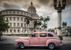 An old American car in front of the Capitolio in Havana Cuba