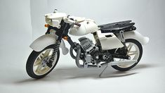 This Eastern European oddity is an air-cooled Jawa 350 motorcycle, a bike that was launched back in the '50s, yetis still in production today. This neat Technic recreation of the Czechoslova…