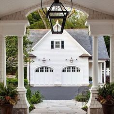 Through the Porte Cochere (or simply a very lovely breezeway?) and on to the Garage with Guest House, by Wade Weissman Architecture. Porte Cochere, Detached Garage Designs, Mansion Homes, Garage Double, Haus Am See, Gas Lanterns, Breezeway, Exterior Lighting, Garage Lighting