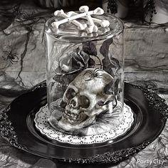 Skull + spooky Halloween stuff + overturned vase = centerpiece to shriek about!