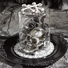 Skull + spooky Halloween stuff + overturned vase = centerpiece to shriek about! Click for lots more Halloween decorating ideas!