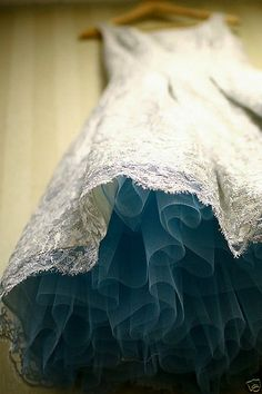 Lace dress with a teal crinoline petticoat  (via Gorgeous Wedding Things / I love the angle the dress is photographed from in this picture!)