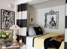 What a great space - historic black and white decal juxtaposes a piece of modern art in the same colours, pale panelling, bold black and white curtains shielding the alcove bed and pale custard coloured throw edged in black. There is an upmarket artists garret feel about this gorgeous bedroom.