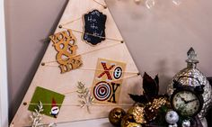 Ken Wingard | DIY Christmas Card Tree | Home & Family on Hallmark Channel | mark tree lines on painter's tape, use jigsaw to cut through wood/tape, pull off tape for smooth edges; reverse ribbon at tacks