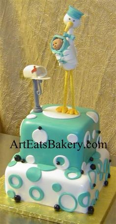 pictures of shower cakes for girls with cow design   Two tier square teal, black and white polka dot cake with stork, baby ...