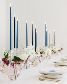 modern fine art wedding table decor blue, ivory, and pink