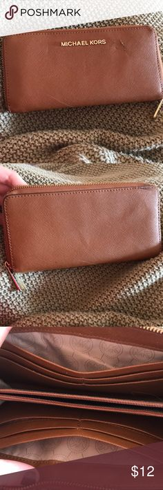 Michael Kors brown leather wallet So there's a tear near the logo on the front that I'm not even sure could be repaired?  But there's times when it's less noticeable that others  Also a small scratch on the bottom that may be able to be buffed out   Definitely loved but has more years left in it! Michael Kors Bags Wallets