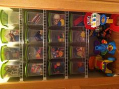 Closet toy storage in playroom.- I wish our closets looked like this!