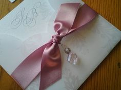 wedding invitation with ruband and jewelry