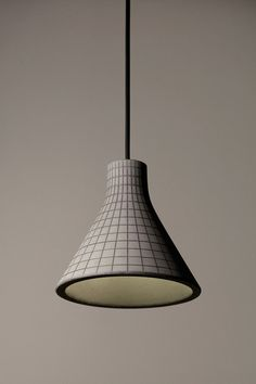 Studio Itai Bar-On's concrete lamps are patterned with grids