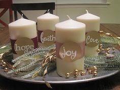 Advent wreath with candles marked for hope, faith, love and joy