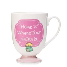 """Show your love with this adorable mug! An adorable, footed mug with the words """"Home is where your mom is"""". FEATURES •3 1/3″ diam. x 4 1/2″ H • Not microwaveable MATERIALS •…"""