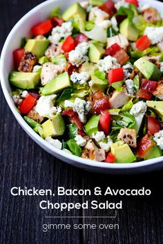 Chicken, Bacon & Avocado Chopped Salad  2 boneless, skinless chicken breastssalt and pepper1 Tbsp. olive oil8 cups chopped Romaine lettuce8 slices bacon, cooked and diced4 ounces blue cheese, crumbled2 avocados, pitted and diced2 roma tomatoes, diced1/4 cup garlic vinaigrette (see recipe below)1/4 cup chopped green onionsGarlic