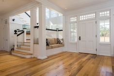 Simple yet elegant front entrance in white with wood flooring. Small built-in sofa is to the right of the front door. Stairwell is also to the right which is brightly illuminated with two stories of windows. Bar Restaurant Design, Hallway Ideas Entrance Narrow, Foyer Ideas, Modern Hallway, Modern Staircase, Entryway Bench, Built In Sofa, Architecture Restaurant, House Architecture