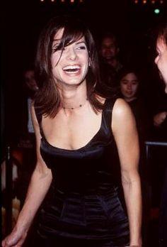 Sandra Bullock's having a blast at the movie's premiere. Cool dress!