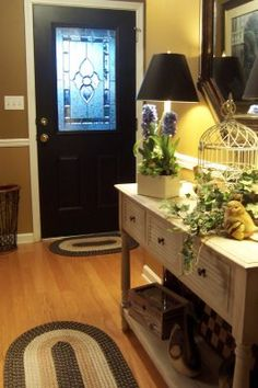 love black doors . . . love the entry table decor