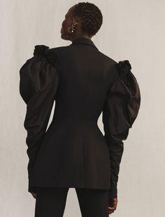 A wool silk tuxedo jacket with exploded rose taffeta sleeves.