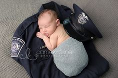 Baby with police officer's uniform