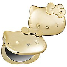 """2012 Year Of The Dragon Compact Mirror  What it is:  A gold-toned Hello Kitty compact mirror.    What it does:  Feeling amazingly gorgeous begins with this sparkling Hello Kitty mirror. A shiny gold metallic finish covers the surface of its durable plastic component. It opens to reveal two mirrors with 1x and 3x magnification. To celebrate Chinese New Year and the year of the dragon, it comes in a special commemorative box. The Chinese characters for """"Happy New Year"""" add another festive…"""