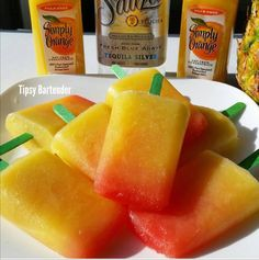 TEQUILA SUNRISE POPSICLES  1 cup pineapple chunks 1 cup OJ 1/4 cup Tequilla  1 tsp grenadine each  Instructions Combine all ingredients (except for the grenadine) in a blender. Blend until smooth. Pour into popsicle molds. Add a teaspoon of grenadine into each popsicle mold(DO NOT stir. The grenadine will slowly make its way to the bottom on its own). Freeze.