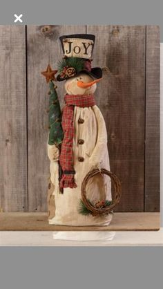 Cute snowman with wreath, Christmas tree, tall hat and scarf. Primitive Wood Crafts, Primitive Snowmen, Primitive Christmas, Christmas Snowman, Rustic Christmas, Winter Christmas, Christmas Ornaments, Snowman Decorations, Snowman Crafts