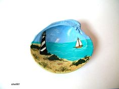 Lighthouse clam shell seashell art beach coastal decor sailboat and the sea. $13.99, via Etsy.