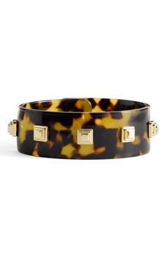 tory burch - This would be so easy to make!  Just glue some beads or jewelry findings to an old bangle.