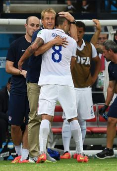Moment #7 - Everyone needs a hug United States' head coach Juergen Klinsmann hugs United States' Clint Dempsey as Dempsey is substituted during the group G World Cup soccer match between the USA and Portugal at the Arena da Amazonia in Manaus, Brazil, Sunday, June 22, 2014. (AP Photo/Paulo Duarte)
