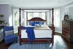 Ashley's Lavidor canopy bed all dressed in blue. Add a pop of color to a neutral room.