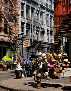 NYC. Hats and Fire escapes // by Alberto Reyes - love the hays and love the store behind it - Sabon!