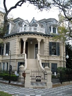 Victorian Trube Castle on Sealy and 17th St. in Galveston, Texas. The 21-room mansion features 32 stained-glass windows, four fireplaces and a widow's walk. Inside, a grand paneled staircase, ceiling reliefs and elaborate chandeliers