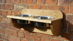 I need to find someone who does woodworking to build me some of these.  I'm so sick of tripping over dog dishes and this is a great idea!  But these are from Great Britain...