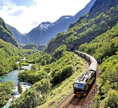 The Flåm Railway - Norway   A steep railway taking you by spectacular waterfalls, in and out of snow-capped mountains and ending up by the Aurlandsfjord.