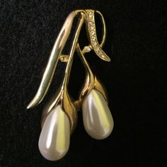 """HOST PICK 4/20Vintage Brooch HOST PICK 4/20/15 Pretty, Flirty & Girly Party Gold tone pin with pearlescent teardrop shape accents. Also has tiny, shiny diamond-like stones in the short """"leaf."""" Accessories"""