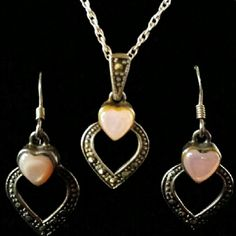 """VINTAGE Pink Mussel and Marcasite Silver Heart Set These dangling pierced earrings and pendant are set with margarita in the silver hearts and at the top,of each is a heart shaped piece of polished pink mussel shell. The hearts on the earrings measure approx 3/4 of an inch and the pendant including the beautifully margarita encrusted bale is 1 inch long. Hanging from a vintage 16"""" sterling silver chain. Stamped 925 ND Vintage Jewelry"""