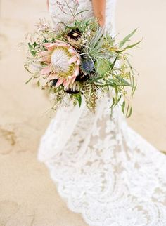 Protea is one of the latest trends in so have a look at the ideas to make your wedding super trendy! Protea bouquets are awesome and very original – just take one or several flowers. Protea Wedding, Floral Wedding, Wedding Bouquets, Wedding Flowers, Wedding Bells, Wedding Dresses, Protea Bouquet, Protea Flower, Dusty Blue