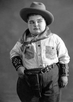 """Joe Cobb was a child actor, most notable as the original """"fat boy"""" in the Our Gang comedies from 1922 to 1929. He was a recognizable character, with chubby cheeks and a trademark beanie cap. His last film as a regular cast member was Boxing Gloves in 1929 when he was twelve. In all he appeared in 86 Our Gang episodes during his seven years in the series. Cobb also made three cameo appearances in the 1930s, Fish Hooky in 1933, Pay as You Exit in 1936 and Reunion in Rhythm in 1937 Golden Age Of Hollywood, Hollywood Stars, Classic Hollywood, Old Hollywood, Silent Film Stars, Movie Stars, Comedy Short Films, Star Children, Child Actors"""