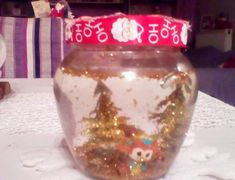 """Materials needed: Small, waterproof toys or figurines, waterproof craft glue or hot gun glue, water and glitter  Decide where you'd like to place your figurines inside the jar by experience don't place them on  your mason jar lid,  the water will drip. Once your figurines are completely pour about a tablespoon of glitter into your jar for the """"snow.""""Pour water into the jar, but do not fill all the way,  Your water line should not reach all the way to the brim then cover the jar lid with… Diy Snow Globe, Snow Globes, Mason Jar Lids, Glue Crafts, Gun, Fill, Handmade Items, Glitter, Seasons"""