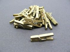 This listing is for a set of 25 mini clothespins in metallic gold. You can use these little clothespins to decorate your gifts, party favors, as establishments on your handmade cards, etc. 50th Wedding Anniversary, Gold Hands, Party Favors, Diy Crafts, Hand Painted, Clothespins, Metallic Gold, Mini, Gifts